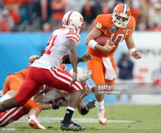 Cullen Harper of the Clemson Tigers scrambles for yardage during the Konica Minolta Gator Bowl against the Nebraska Cornhuskers at Jacksonville...