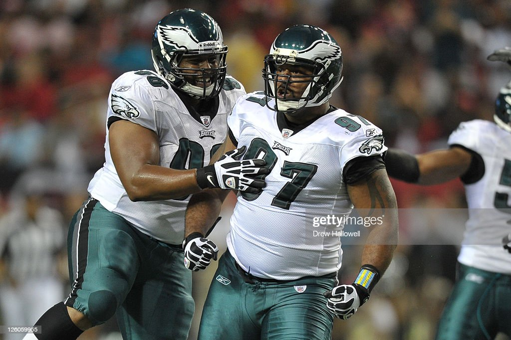 Cullen Jenkins and Mike Patterson of the Philadelphia Eagles celebrate a sack during the game against the Atlanta Falcons at the Georgia Dome on...