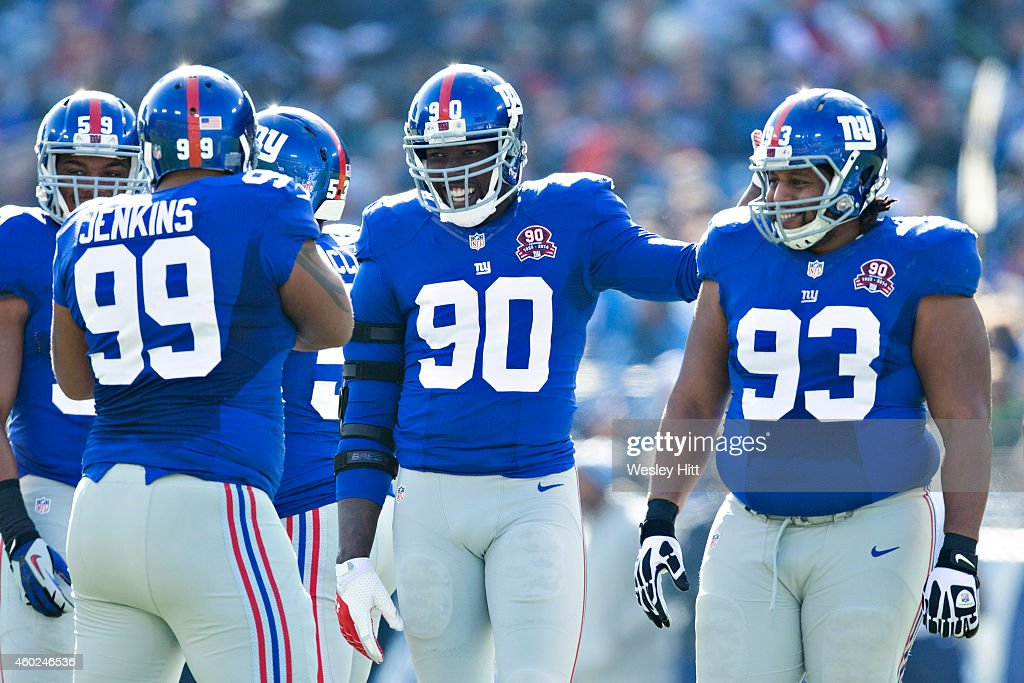 Cullen Jenkins Johnathan Hankins Mike Patterson and Jason PierrePaul of the New York Giants joke around at the line of scrimmage in the first quarter...