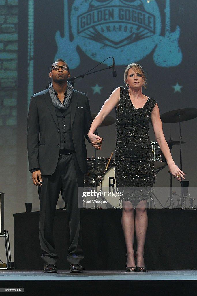 Cullen jones l and kara lynn joyce attend the 2011 golden goggles at