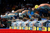 Cullen Jones dives off of the starting block as he competes in preliminary heat 16 of the Men's 50 m Freestyle during Day Six of the 2012 US Olympic...