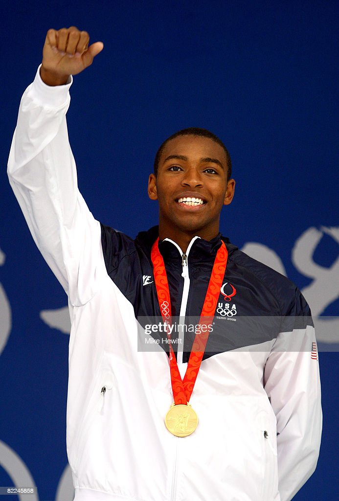 <a gi-track='captionPersonalityLinkClicked' href=/galleries/search?phrase=Cullen+Jones&family=editorial&specificpeople=1047215 ng-click='$event.stopPropagation()'>Cullen Jones</a> of the United States poses with the gold medal during the medal ceremony for the Men's 4 x 100m Freestyle Relay held at the National Aquatics Center on Day 3 of the Beijing 2008 Olympic Games on August 11, 2008 in Beijing, China.
