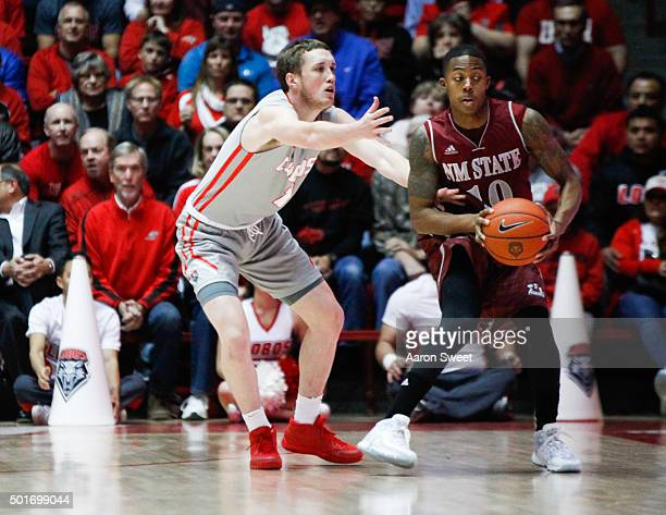 Cullen Neal of the New Mexico Lobos guards Rashawn Browne of the New Mexico State Aggies during their game at The Wise Pies Arena on December 16 2015...