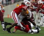 Culmer St Jean of the Wisconsin Badgers brings down Deantre Lewis of the Arizona State Sun Devils at Camp Randall Stadium on September 18 2010 in...