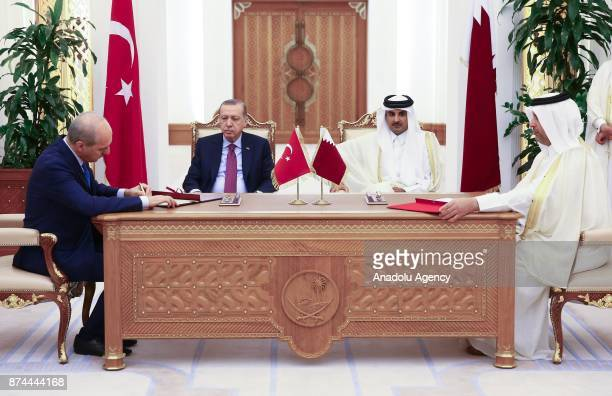 Culture and Tourism Minister of Turkey Numan Kurtulmus signs an agreement on behalf of Turkey as he is flanked by President of Turkey Recep Tayyip...