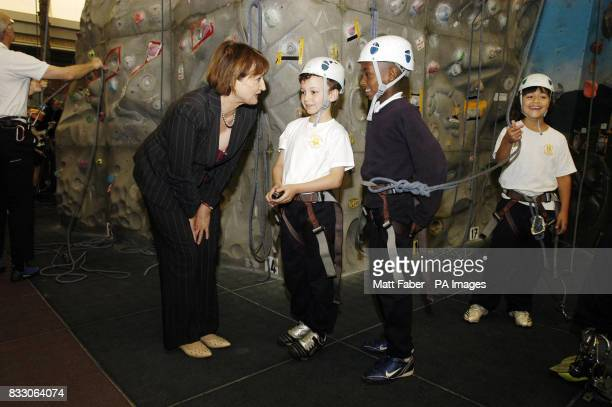 Culture Minister Tessa Jowell talks to a students from Oxford Gardens Primary School at the Westway Sports Centre in London which is funded by...