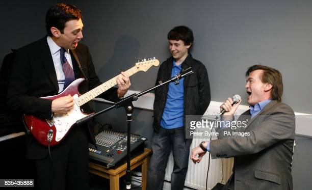 Culture Secretary Andy Burnham and UK Music Chief Executive Feargal Sharkey play Teenage Kicks during the opening of a professionally equipped...