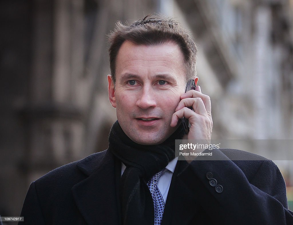 Culture Secretary Jeremy Hunt speaks on an iphone as he walks from Parliament on March 3, 2011 in London, England. The British government has given the go-ahead for Rupert Murdoch's News Corporation to takeover satellite broadcaster BSkyB. The deal has been allowed after News Corporation offered to spin off Sky News.