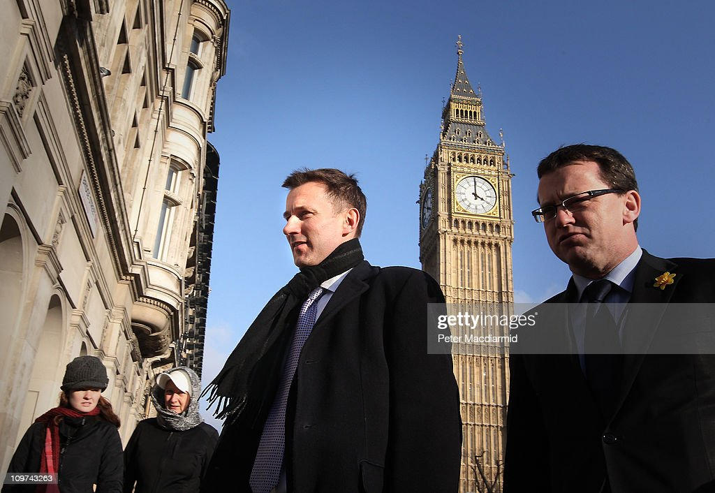 Culture Secretary Jeremy Hunt (C) walks from Parliament on March 3, 2011 in London, England. The British government has given the go-ahead for Rupert Murdoch's News Corporation to takeover satellite broadcaster BSkyB. The deal has been allowed after News Corporation offered to spin off Sky News.