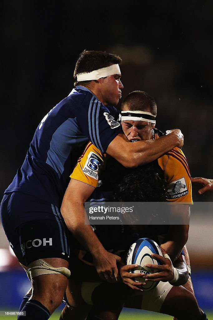Culum Retallick of the Blues tackles <a gi-track='captionPersonalityLinkClicked' href=/galleries/search?phrase=Brodie+Retallick&family=editorial&specificpeople=7864021 ng-click='$event.stopPropagation()'>Brodie Retallick</a> of the Chiefs during the round seven Super Rugby match between the Chiefs and the Blues at Bay Park on March 30, 2013 in Tauranga, New Zealand.