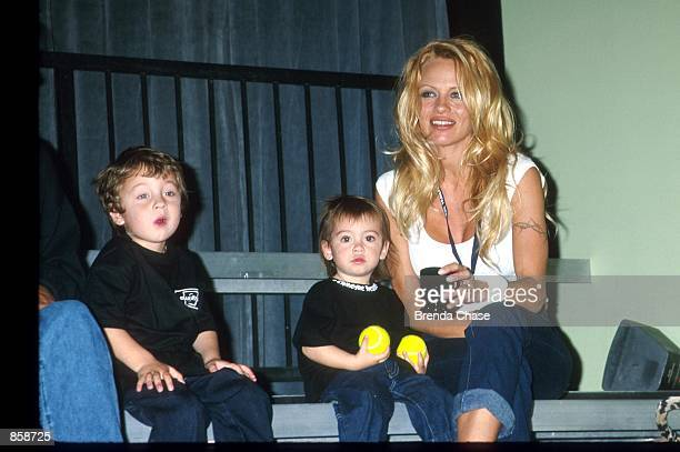01/15/00 Culver City CA Pamela Anderson Lee with her kids Brandon Dylan attending the Mtv's BALL2K a new interactive futuristic game based on the...