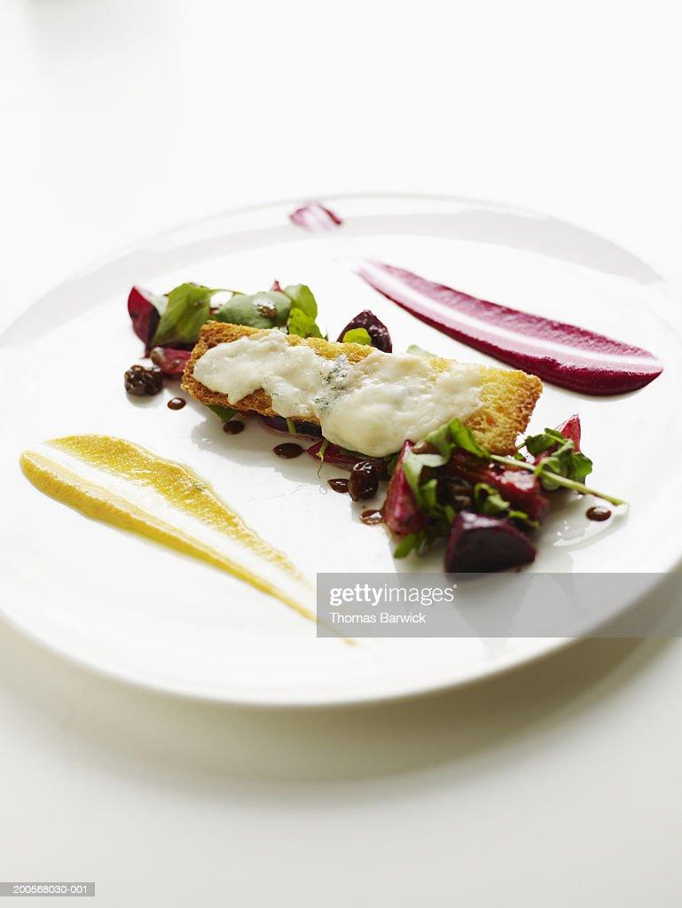 Cumin and citrus baby beet salad with gorgonzola crouton : Stock Photo