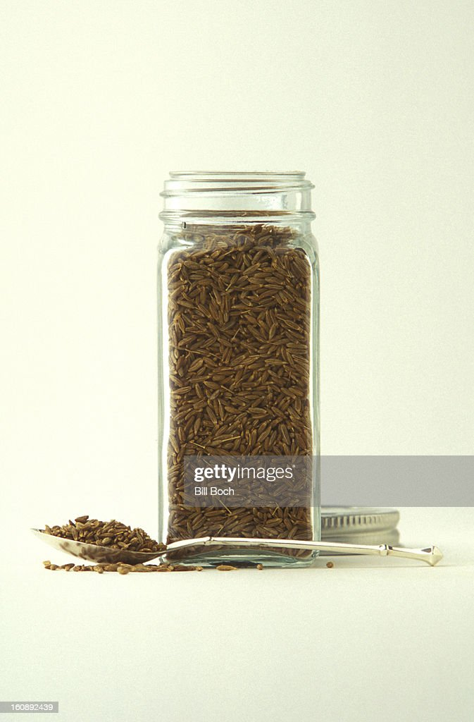 Cumin seeds in a bottle : Stock Photo