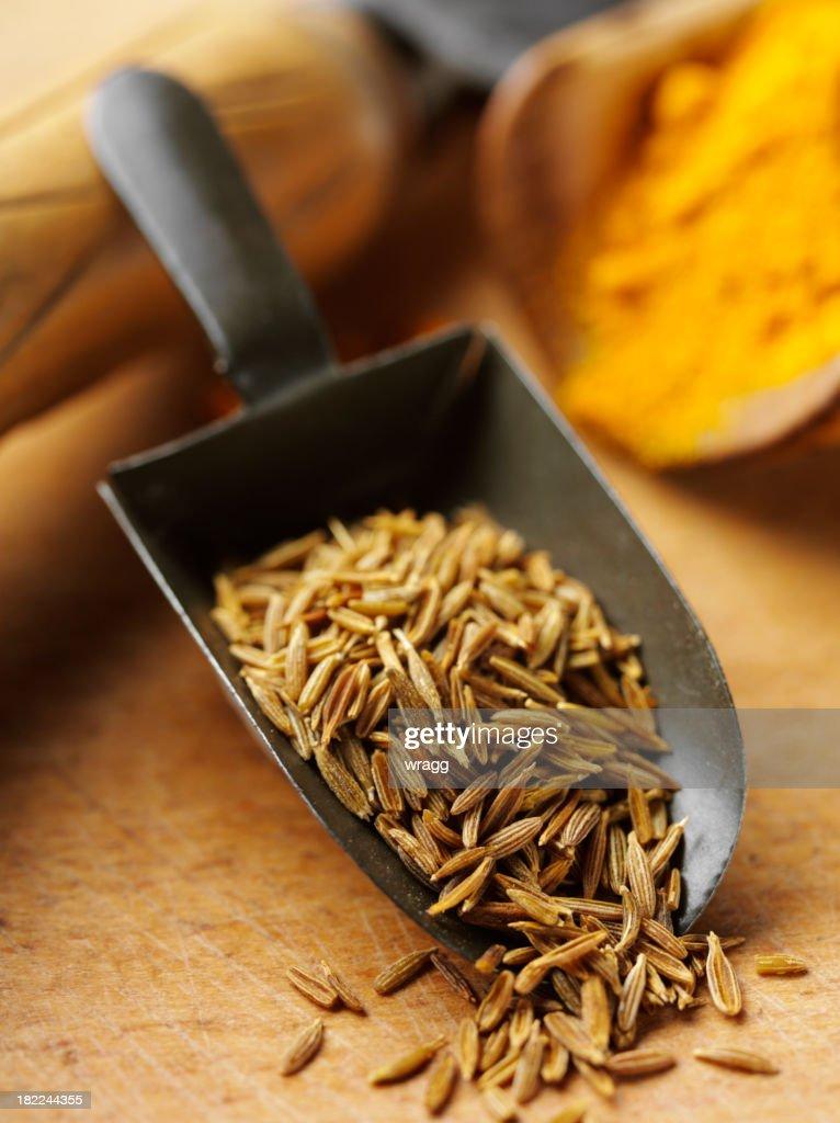 Cumin Seeds in a Old Metal Scoop