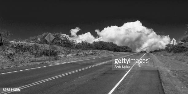 Cumulus cloud over Route 270 in North Kohala, Hawaii