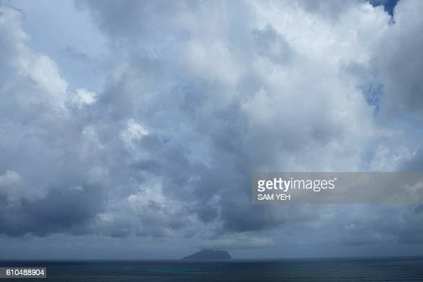 Cumulus clouds are seen above Turtle Island near Yilan county eastern Taiwan as typhoon Megi approaches on September 26 2016 Taiwan evacuated...
