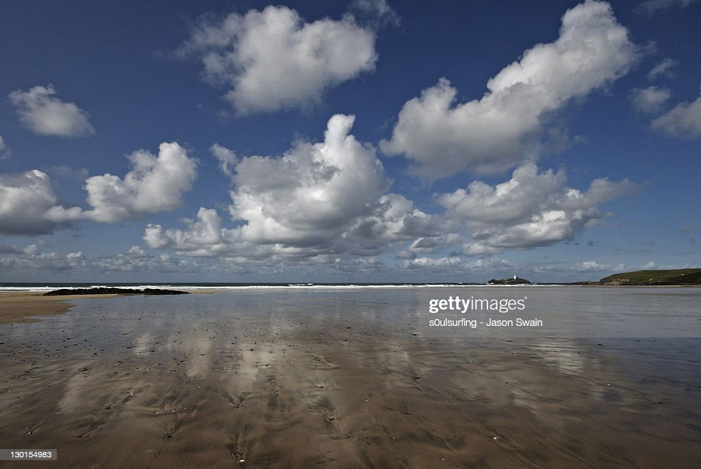 Cumulus clouds over sands : Stock Photo