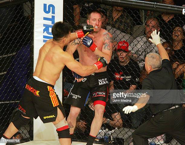 Cung Le delivers a blow to opponent Brian Warren during the StrikeForce mixed martial arts event at HP Pavilion on June 9 2006 in San Jose California...
