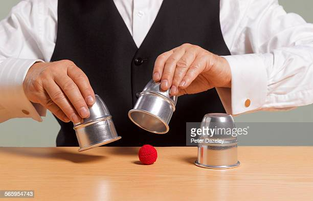 Cup and ball gambling game
