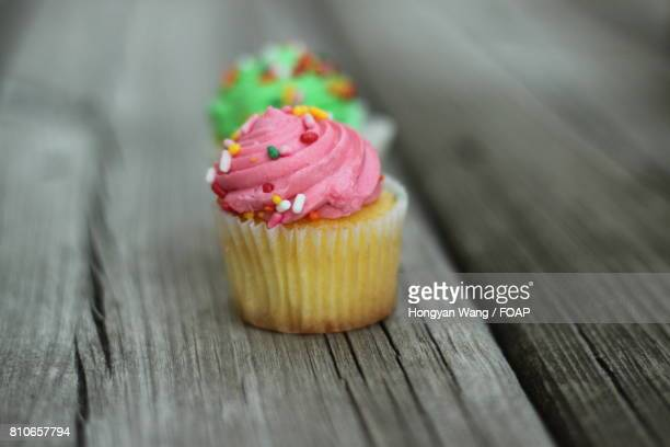 Cup cake on wooden table
