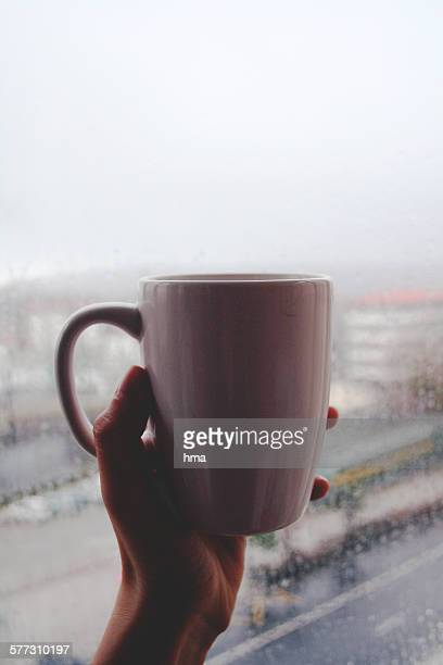 Cup coffee on a rainy day