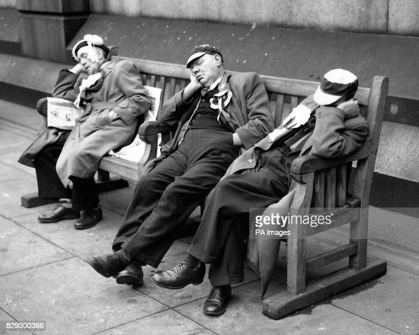 Cup Final nerves take a sedative on a seat in Trafalgar Square where these Manchester city supporters rested in readiness for their team's exertions...