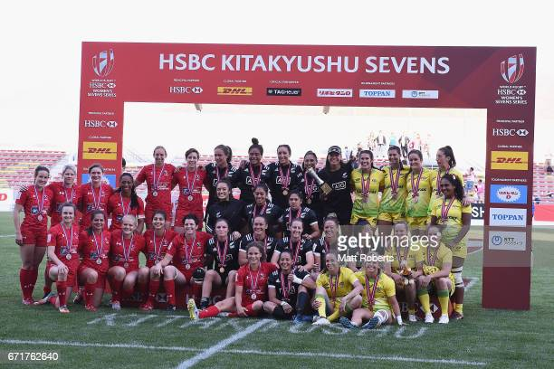 Cup final winners New Zealand pose for a photo with second place Canada and third place Australia after to the HSBC World Rugby Women's Sevens Series...