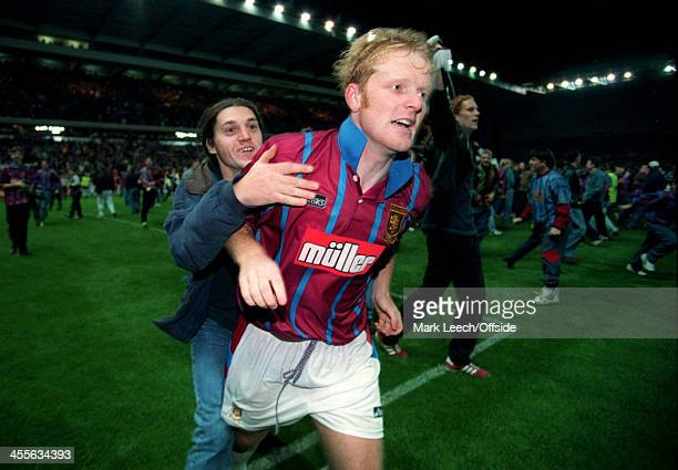 Cup Football Aston Villa v Internazionale Phil King celebrates the Villa victory with pitch invading fans