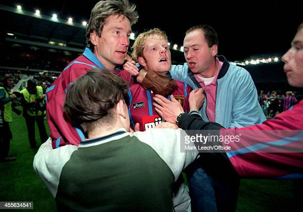 Cup Football Aston Villa v Internazionale Phil King is surrounded by fans as they celebrate the Villa victory one has a gloved hand around the neck...