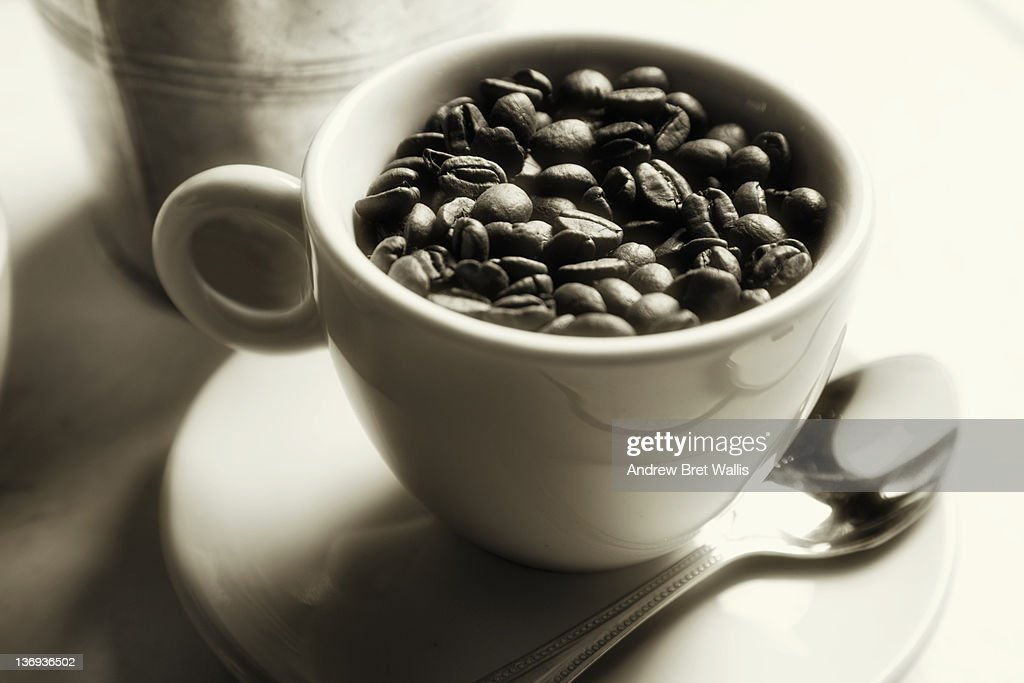 Cup Full Of Fresh Whole Coffee Beans Stock Photo