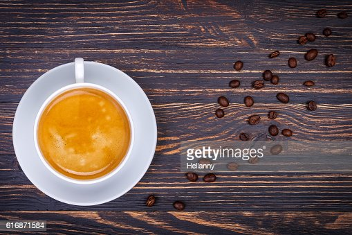 Cup hot coffee at saucer from beans : Stock Photo