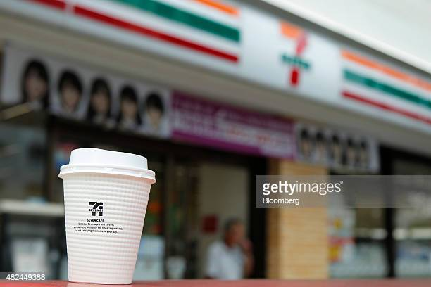 A cup of black coffee is displayed for a photograph outside a 7Eleven convenience store operated by Seven I Holdings Co in Tokyo Japan on June 30...
