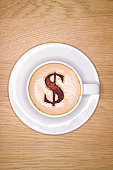 Cup of Cappachino with a Dollar Symbol made from Choclate on top