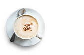 Cup of cappuccino isolated on the white background, clipping path.