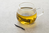 Glass cup of natural Chinese Kuding needle tea