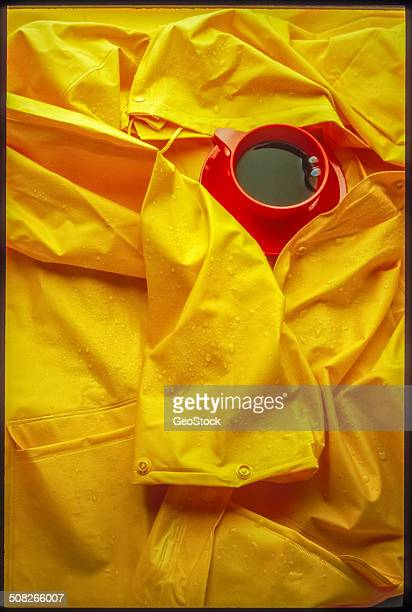 A cup of coffee and a yellow raincoat