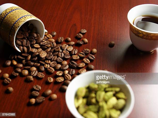 Cup of coffee and beans on a table.