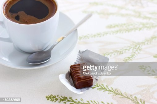 Cup of coffee and chocolate candy : Stock Photo