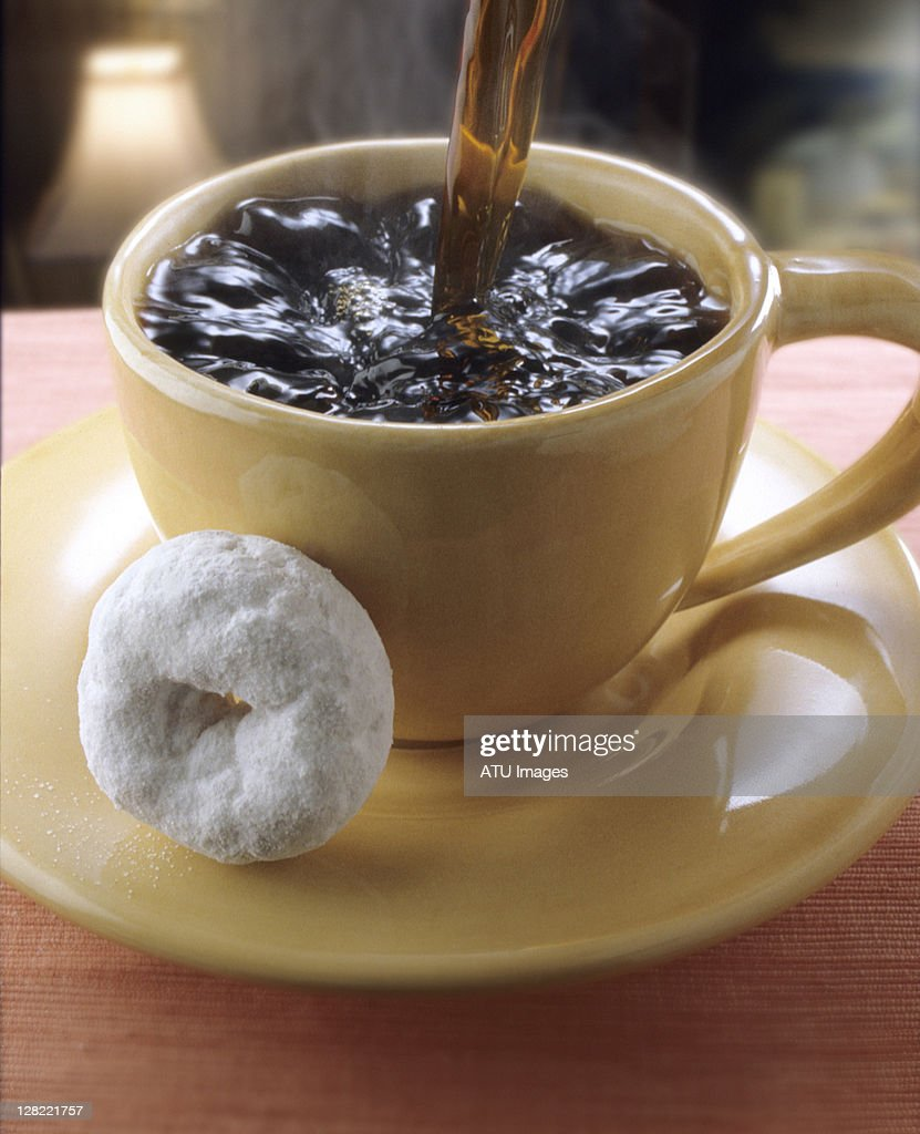 Cup of coffee and donut : Stock Photo