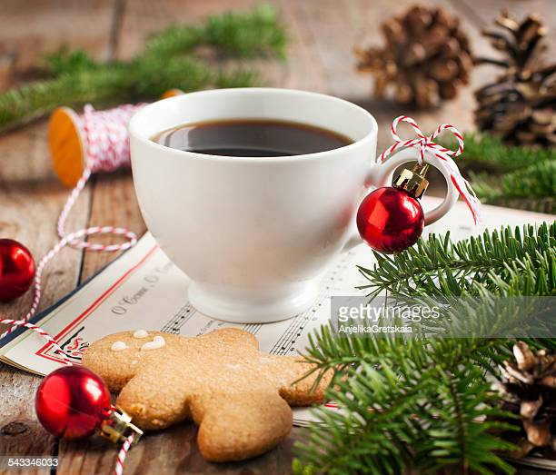 Cup of coffee and gingerbread cookie with christmas decorations