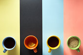 cup of coffee and ingredients at paper background