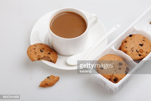 cup of coffee and some wheat crackers : Stock Photo