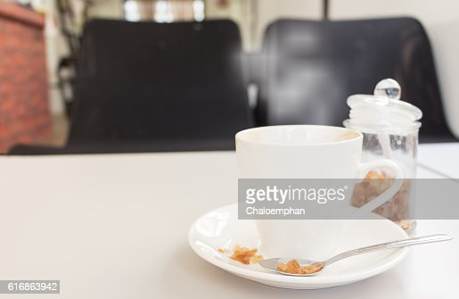 cup of coffee and sugar with magazine on white wood : Stock Photo