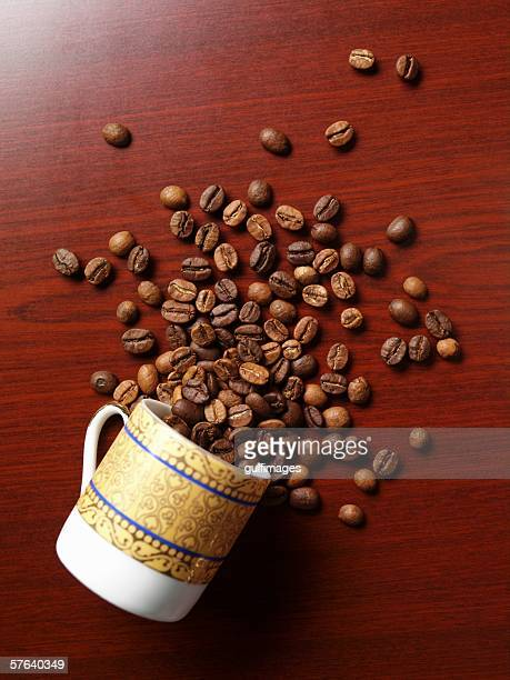 Cup of coffee beans on a table.