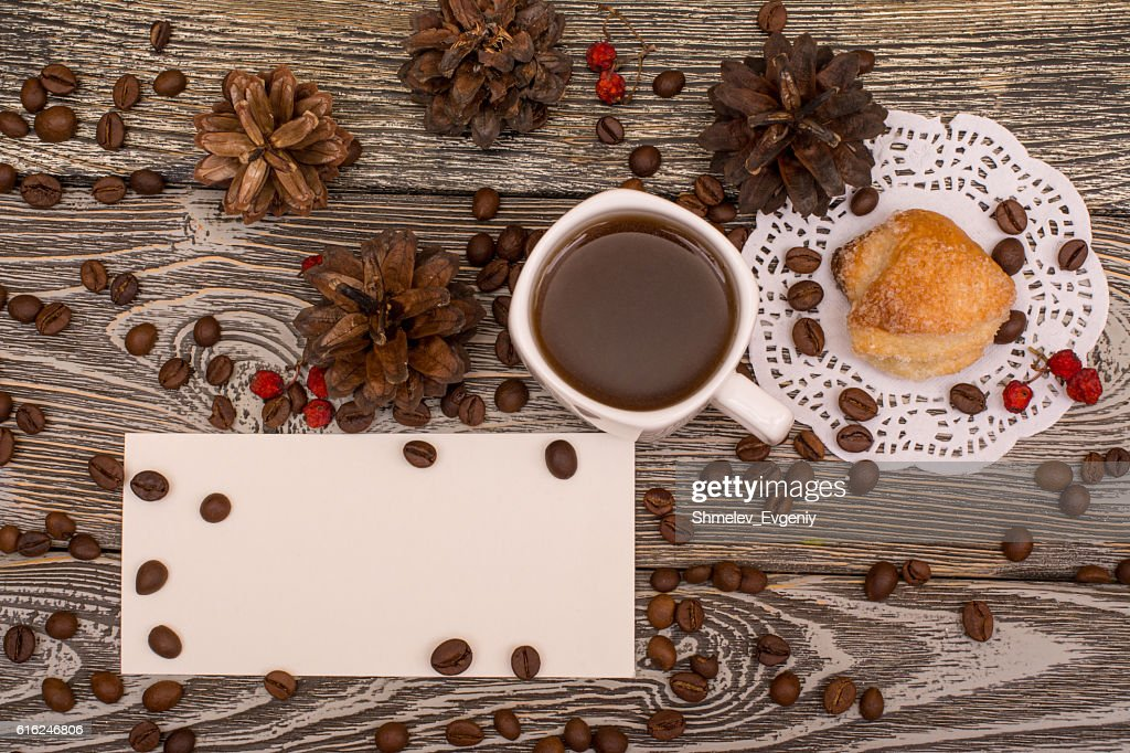Cup of coffee, cookies, beans on wooden background. Template : Stock Photo