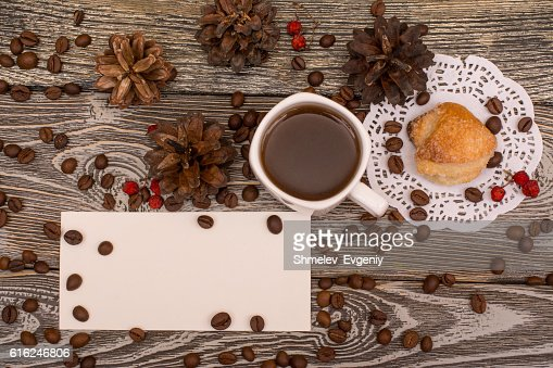 Cup of coffee, cookies, beans on wooden background. Template : Foto stock