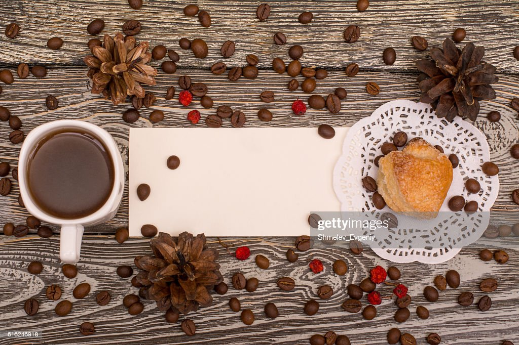Cup of coffee, cookies, beans on wooden background. Template : Stock-Foto