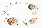 Christmas composition. Cup of coffee, gift, larch branches, cinnamon sticks, anise star, christmas cookies. Flat lay, top view