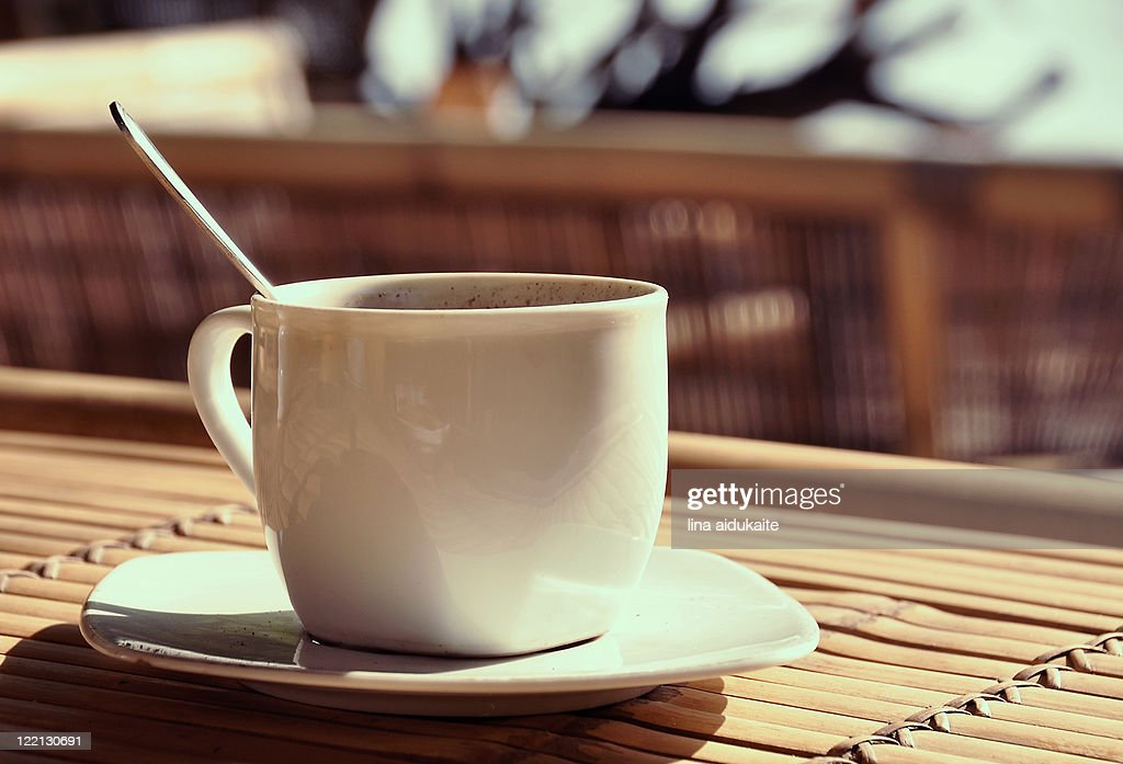 Cup of coffee in sunlight : Stock Photo