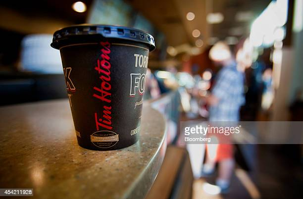 A cup of coffee is displayed for a photograph at a Tim Hortons Inc restaurant in downtown Vancouver British Columbia Canada on Tuesday Aug 26 2014...